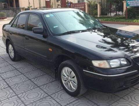 Cần bán Mazda 626 đời 2000, màu đen như mới, 130tr