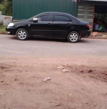 Bán xe Toyota Corolla Altis đời 2005, màu đen như mới, 348 triệu