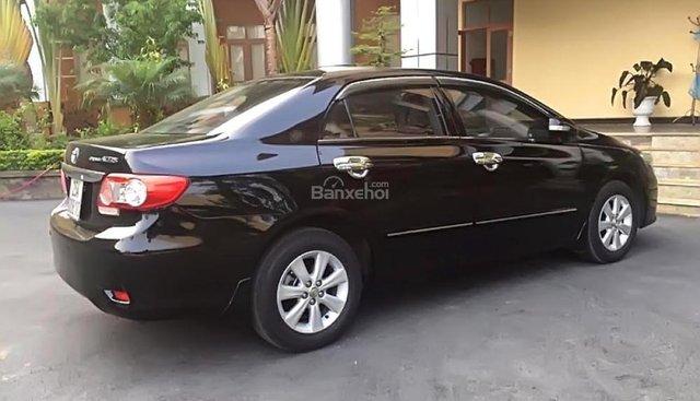 Chính chủ bán ô tô Toyota Corolla altis đời 2014, màu đen