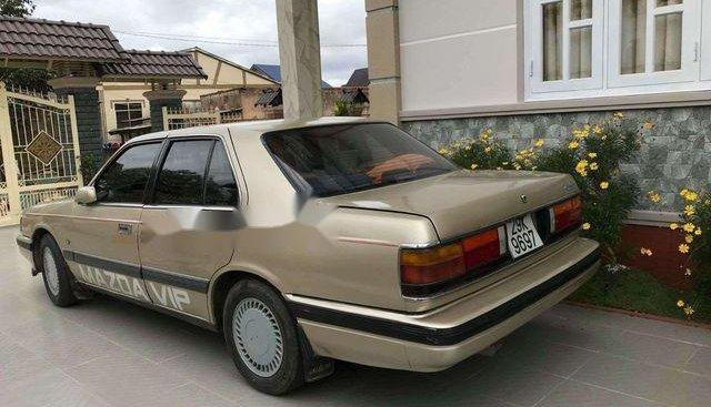Bán ô tô Mazda 626, màu ghi vàng