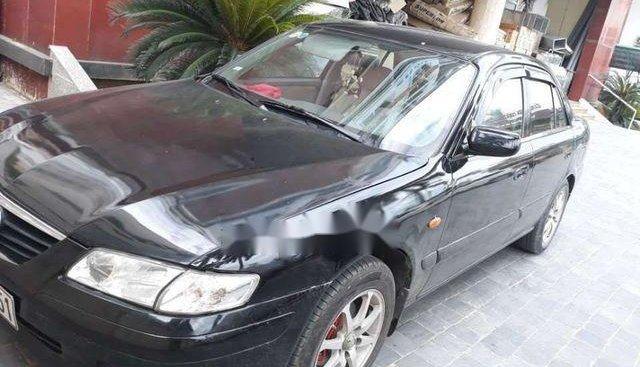 Cần bán xe Mazda 626 đời 2001, màu đen chính chủ, 135tr