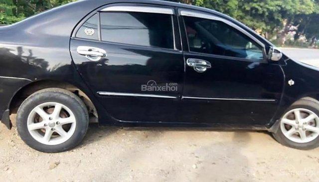 Cần bán lại xe Toyota Corolla Altis 1.8G MT sản xuất năm 2003, màu đen