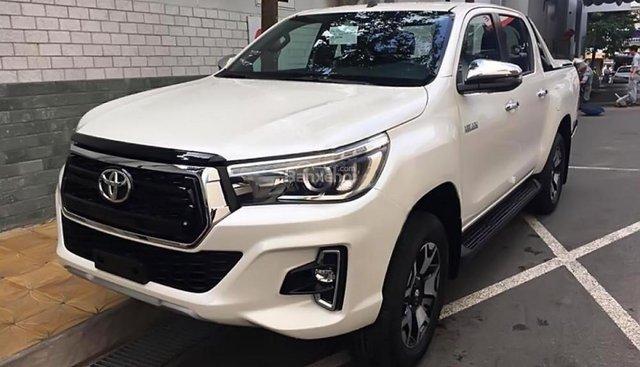 Bán xe Toyota Hilux 2.4G 4x4 AT năm sản xuất 2018, màu trắng