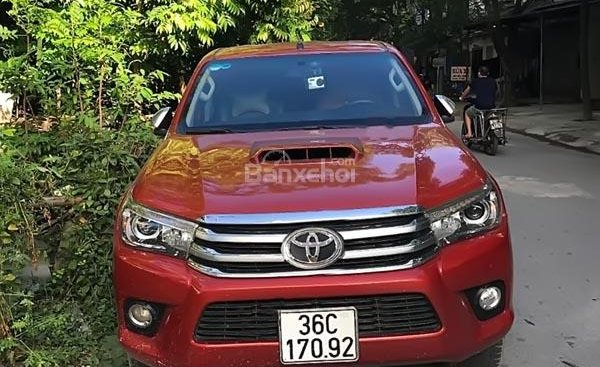 Bán ô tô Toyota Hilux 3.0G 4x4 AT sản xuất 2016, màu đỏ, xe nhập