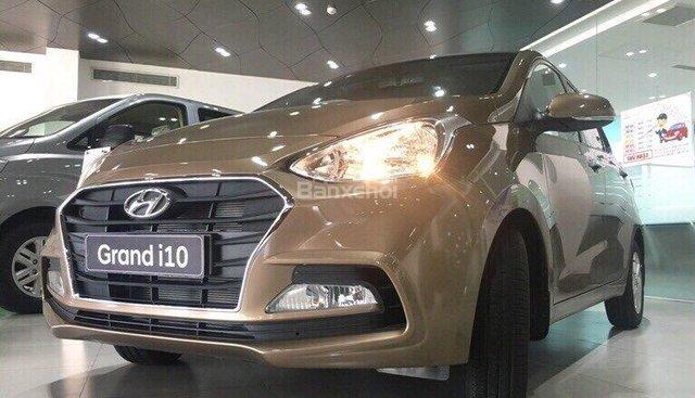 Bán Grand I10 Sedan số sàn, màu nâu, xe có sẵn giao ngay trong tháng