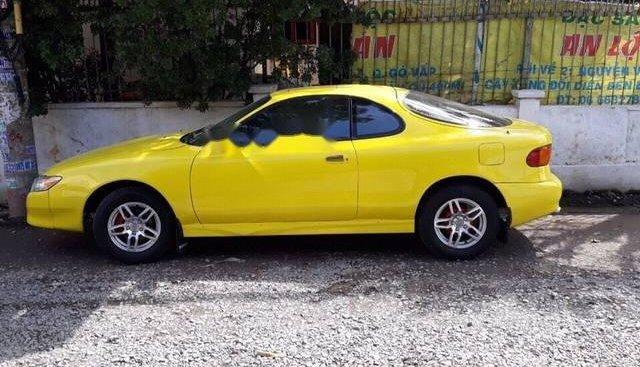 Bán ô tô Toyota Celica sản xuất năm 1993, màu vàng, nhập khẩu chính chủ