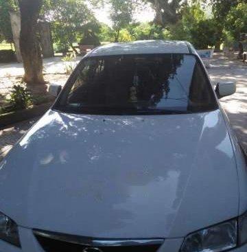 Cần bán một xe Mazda 626, đời 2001 màu trắng