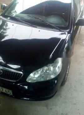 Cần bán xe Toyota Corolla Altis đời 2003, màu đen, giá tốt