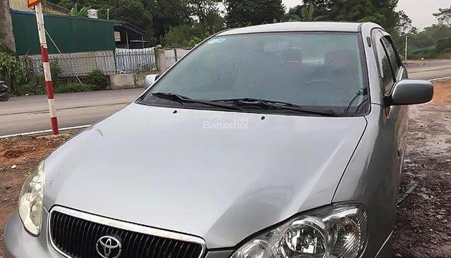 Bán Toyota Corolla đời 2003, màu bạc số sàn