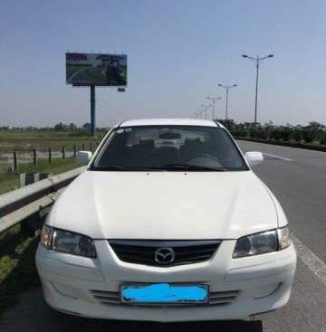 Cần bán xe Mazda 626 đời 2001, màu trắng, giá 138tr