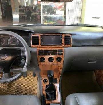 Cần bán Toyota Corolla altis năm 2003, màu đen, 175 triệu