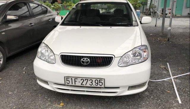 Cần bán xe Toyota Corolla năm sản xuất 2003, màu trắng, 230 triệu