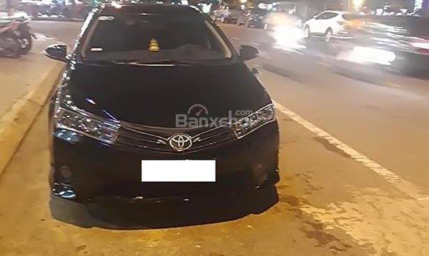Bán gấp Toyota Corolla altis 1.8G MT đời 2014, màu đen