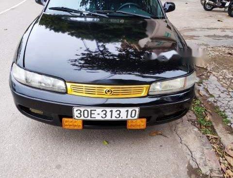 Bán Mazda 626 đời 1997, màu đen, giá 90tr