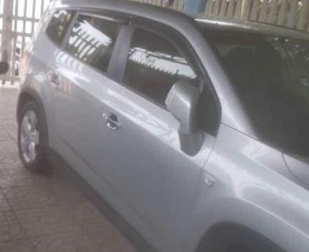 Bán gấp Chevrolet Orlando đời 2014, màu bạc, xe nhập