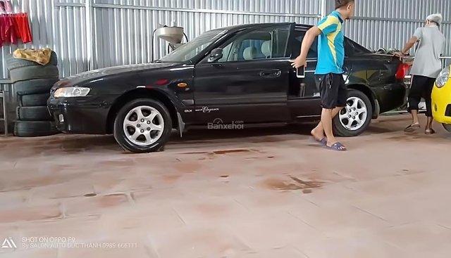 Cần bán gấp Mazda 626 đời 2003, màu đen, giá 186tr