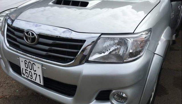Bán Toyota Hilux 3.0G sản xuất 2012, màu bạc, xe nhập chính chủ