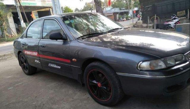 Cần bán gấp Mazda 626 đời 1993, màu xám