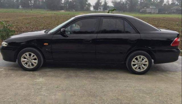 Cần bán gấp Mazda 626 đời 2003, màu đen số sàn, giá tốt