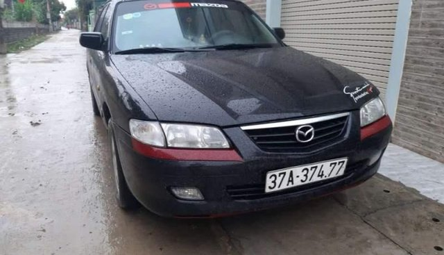 Cần bán Mazda 626 năm sản xuất 2003, màu đen