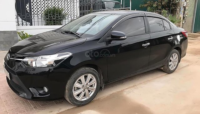 Cần bán Toyota Vios 1.5E đời 2015, màu đen chính chủ