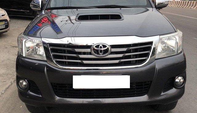 Cần bán xe Toyota Hilux 3.0 năm sản xuất 2014, màu xám máy dầu 3.0, cần bán 525 triệu
