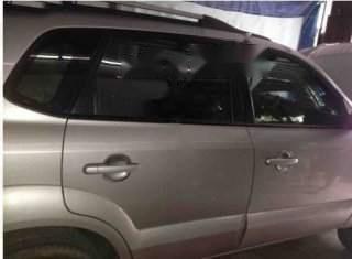Bán gấp Hyundai Tucson 2.0 AT 4WD đời 2009, màu bạc chính chủ