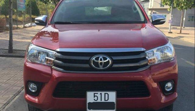 Chính chủ bán xe Toyota Hilux 2.4E 2016, màu đỏ, xe nhập