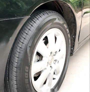 Bán xe Toyota Camry 2.4G 2003, màu đen, số sàn
