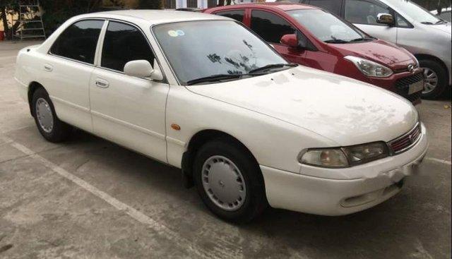Bán Mazda 626 MT năm sản xuất 1997, màu trắng, xe một chủ đi làm nhà nước