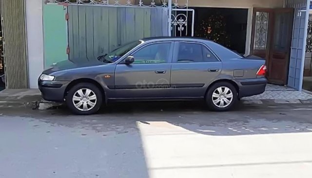 Bán Mazda 626 màu xám xanh, đời 2001, xe đẹp, nội ngoại thất sạch sẽ, khung gầm chắc, máy ổn
