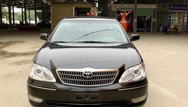 Cần bán xe Toyota Camry, số sàn sx 2005, màu đen, 340tr
