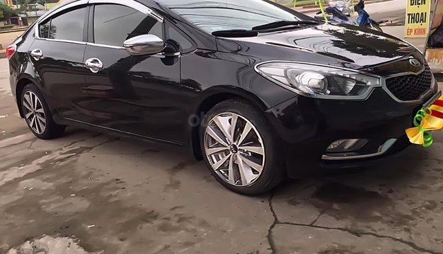 Cần bán xe Kia K3 năm sản xuất 2015, màu đen chính chủ
