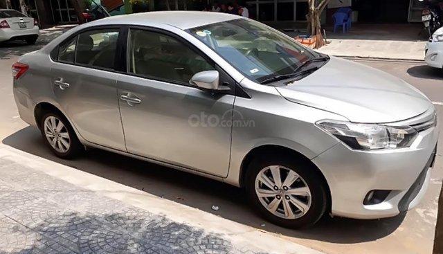 Cần bán xe Toyota Vios 1.5E năm 2014, màu bạc xe gia đình, giá 410tr