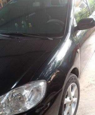 Cần bán gấp Toyota Corolla altis 1.8MT đời 2004, màu đen chính chủ