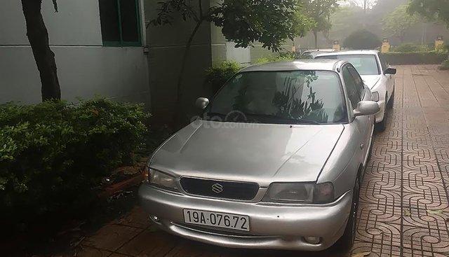 Cần bán gấp Suzuki Baleno Fi 1996, màu bạc, máy êm