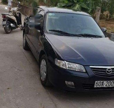 Cần bán lại xe Mazda 626 đời 2001, màu đen, nhập khẩu nguyên chiếc xe gia đình