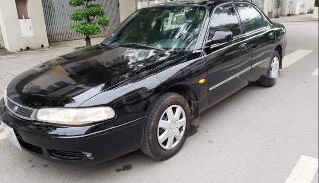 Cần bán xe Mazda 626 đời 2002, màu đen, xe nhập