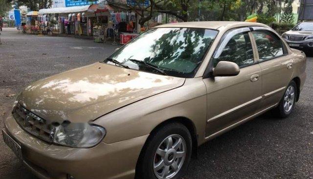Cần bán Kia Spectra sản xuất năm 2004, màu vàng còn mới