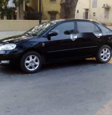 Bán Toyota Corolla altis đời 2004, màu đen xe gia đình