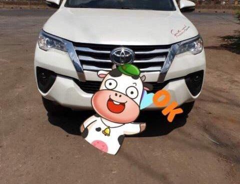 Bán Toyota Fortuner MT 2017, màu trắng như mới
