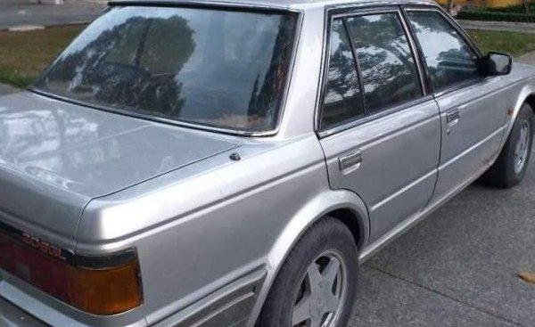 Cần bán xe Nissan Gloria sản xuất năm 1998, màu bạc, nhập khẩu, giá 50tr