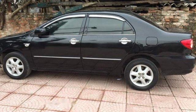Cần bán xe Toyota Corolla altis năm 2004, màu đen, giá chỉ 255 triệu