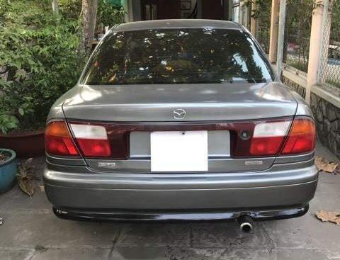 Cần bán xe Mazda 323 đời 1999, màu xám, nhập khẩu nguyên chiếc