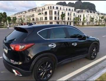 Bán xe Mazda CX 5 sản xuất 2015, màu đen chính chủ, 715 triệu