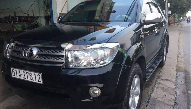 Bán xe Toyota Fortuner sản xuất năm 2011, màu đen xe gia đình, giá 650tr