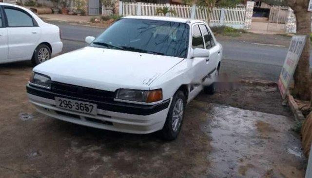 Bán ô tô Mazda 323 đời 1996, màu trắng, xe đang sử dụng hàng ngày