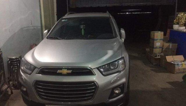 Bán ô tô Chevrolet Captiva đời 2016, màu bạc