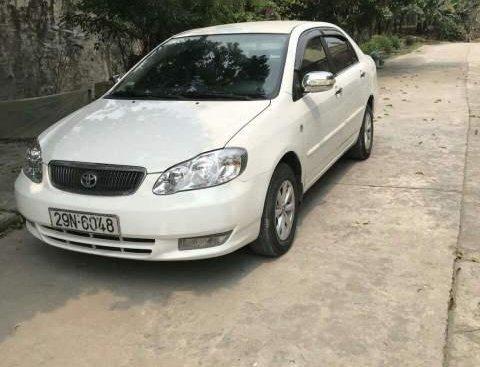 Bán xe Toyota Corolla altis 1.8G sản xuất 2003, màu trắng, nhập khẩu