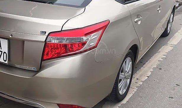 Cần bán gấp Toyota Vios đời 2014, màu vàng, xe gia đình